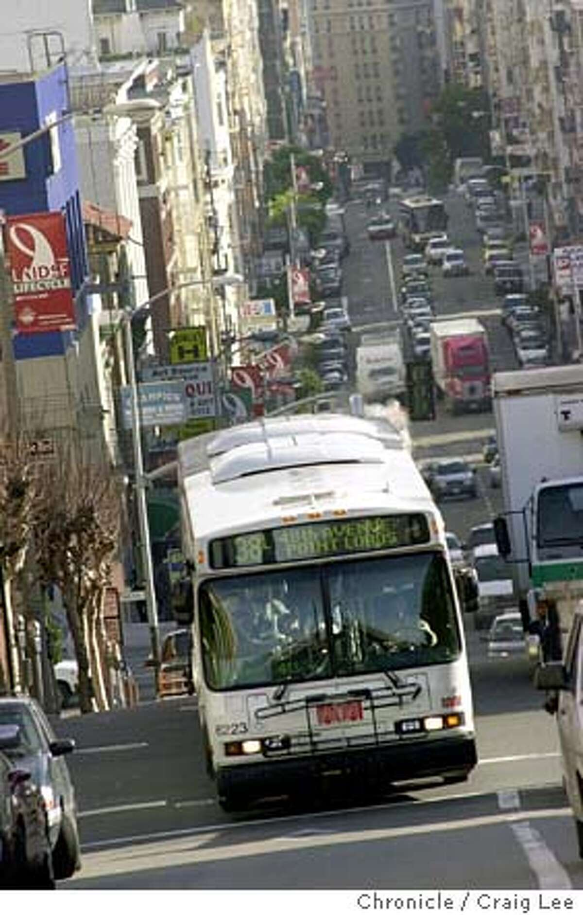 DIESEL-C-04JAN02-SN-CL Photo of one of the dirty diesel spewing Muni buses making it's way up Geary Blvd. Story about how Muni is continuing to buy dirty diesel buses while every other California city is converting to cleaner, quieter buses powered by natural gas. Photo by Craig Lee/San Francisco Chronicle CAT