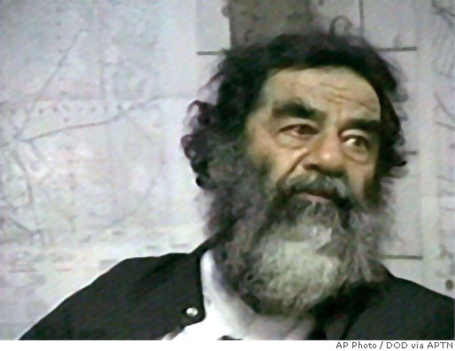 ** FILE ** Captured former Iraqi leader Saddam Hussein is shown in this Dec. 14, 2003 file image from television footage provided by the Dept. of Defense. (AP Photo/DOD via APTN) Saddam Hussein is being questioned by both the FBI and CIA.