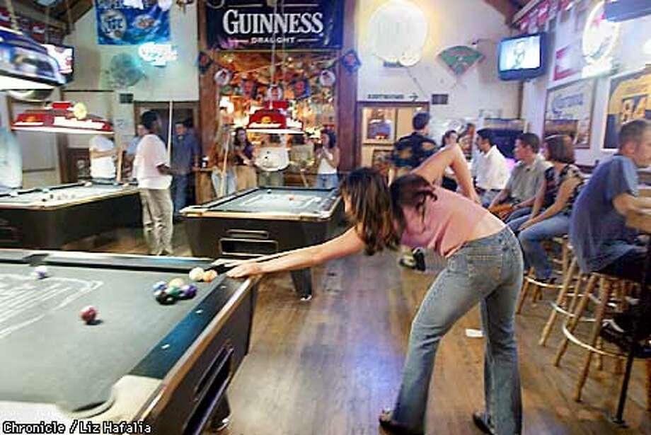 Inside Crogan's playing pool at about 1:45am.  (PHOTOGRAPHED BY LIZ HAFALIA/THE SAN FRANCISCO CHRONICLE) Photo: LIZ HAFALIA