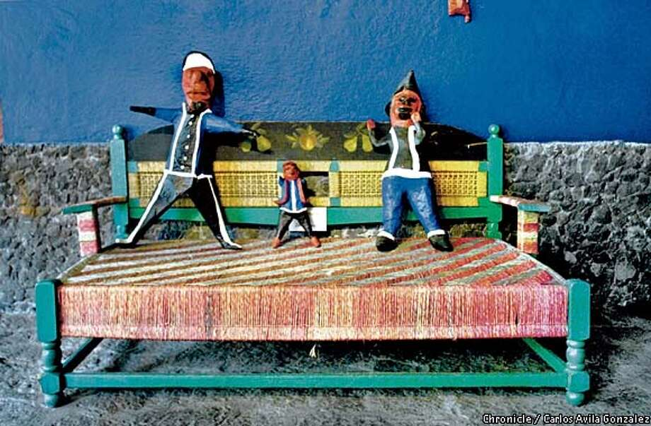 Kahlo Benchmark: A simple woven bench serves as a perfect resting place for artist Frida Kahlo's many paper mache figurines throughout her Casa Azul (Blue House). Chronicle photo by Carlos Avila Gonzalez