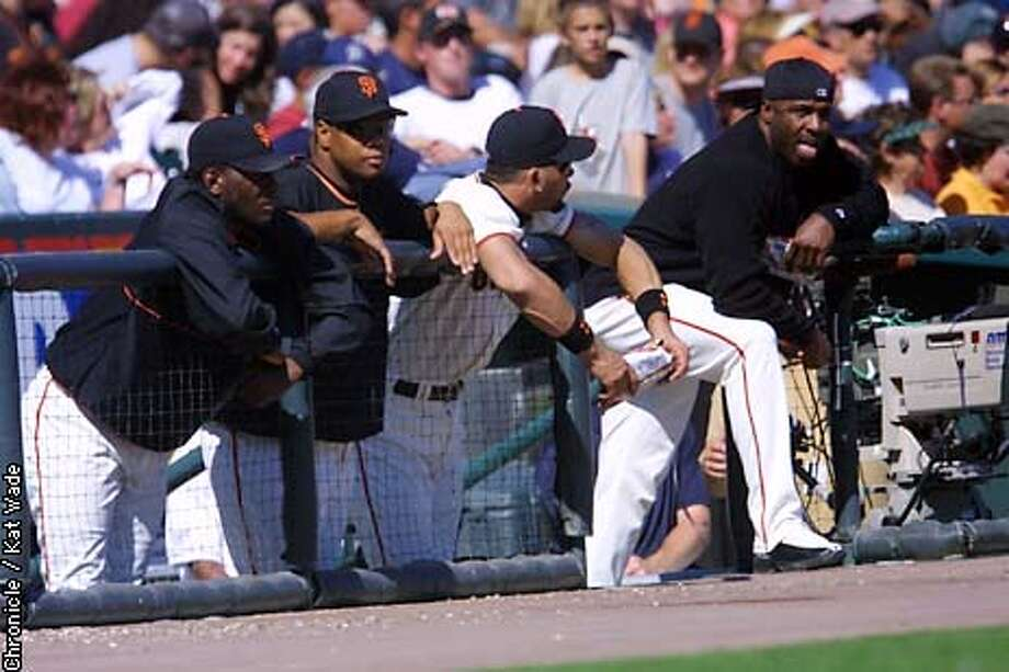 The San Francisco Giants Barry Bonds and Benito Santiago along with other starters watch from the dugout during the game against the Houston Astros at Pac Bell Park Sunday. SAN FRANCISCO CHRONICLE PHOTO BY KAT WADE Photo: KAT WADE