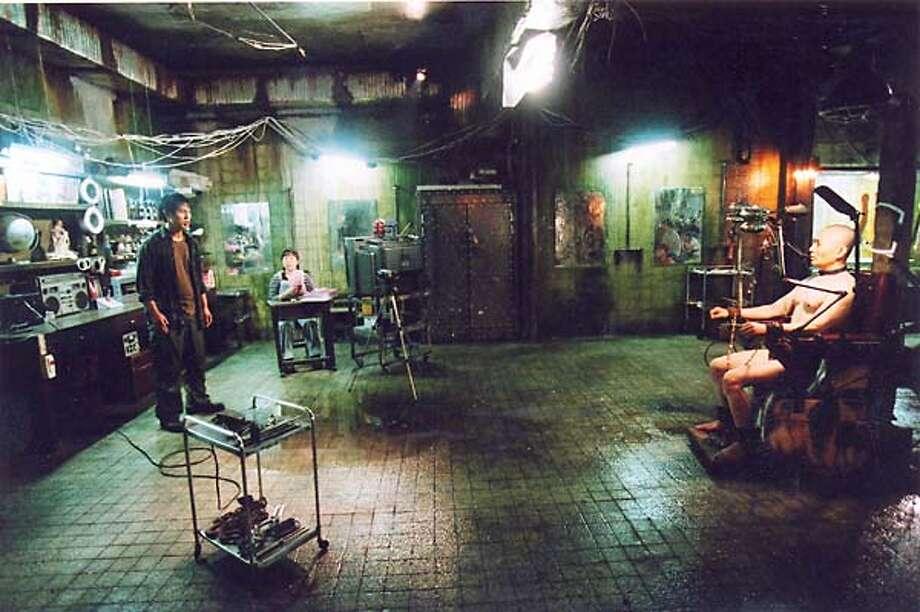 Shin Ha-Gyun, Hwang Jung-min and Baek Yoon-sik in Jang Jun-hwan's dark comedy SAVE THE GREEN PLANET!, playing at 47th San Francisco International Film Festival, April 15 - 29, 2004.