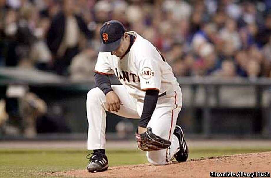 Giants pitcher Russ Ortiz kneels in disgust after giving up seven runs over two innings in the second inning at pac Bell Park. Chronicle Photo by Darryl Bush Photo: Darryl Bush