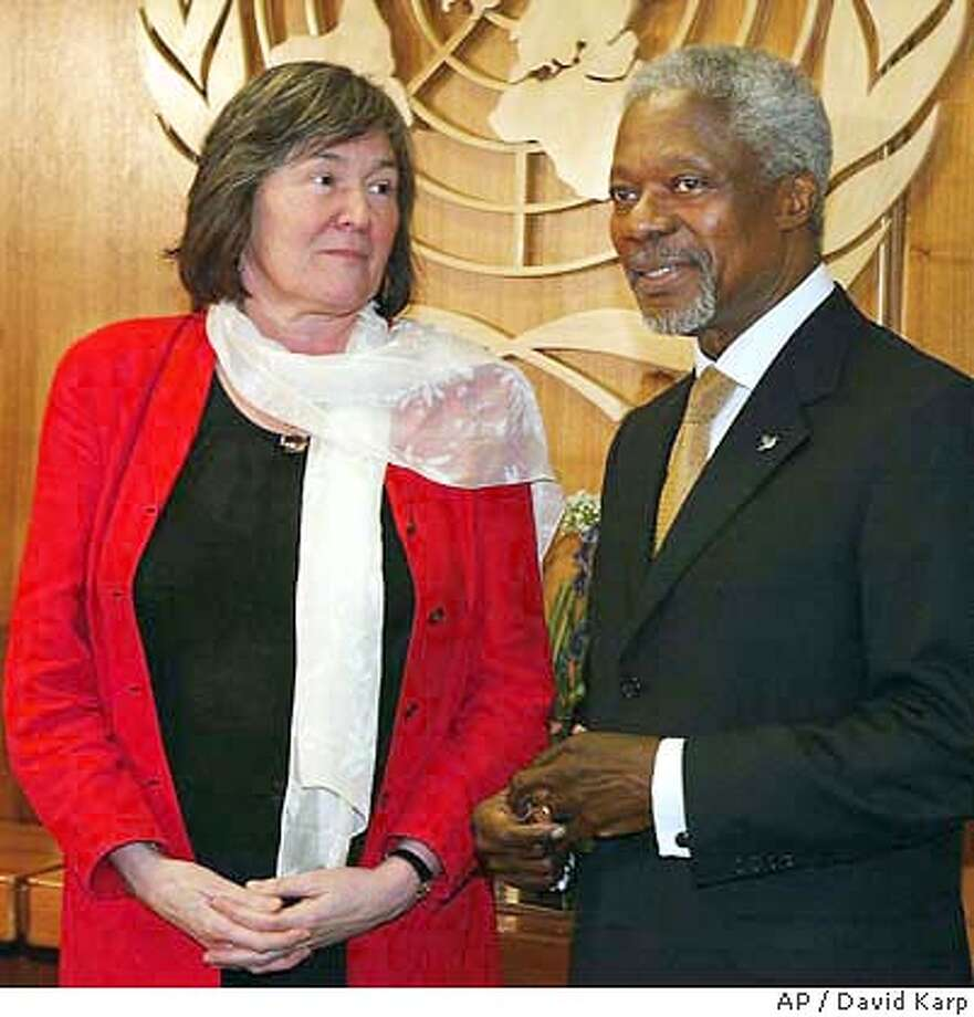 ** FILE ** The then British Secretary of State for International Development Clare Short, left, meets with Secretary General of the United Nations Kofi Annan, at the United Nations, in this March 19, 2003 file photo. Former British government member Short said Thursday Feb. 26, 2004 that British Intelligence agents spied on U.N. Secretary General Kofi Annan in the run up to the Iraq war. (AP Photo/David Karp) Photo: DAVID KARP