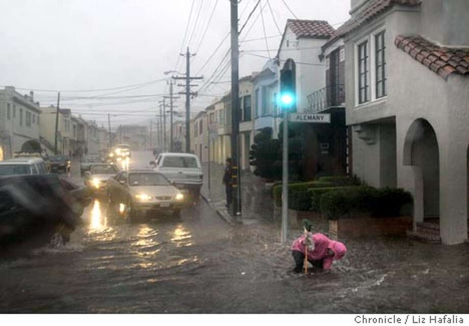 Storm drains didn't handle early downpour fast enough as a flood occured on Alemany Blvd. and Mt. Vernon streets. Shot on 2/25/04 in San Francisco. LIZ HAFALIA / The Chronicle Photo: LIZ HAFALIA