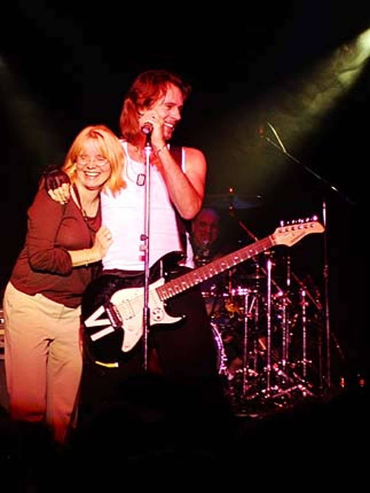 / for: Friday Rita Butzer Carpenter of Palo Alto and Rick Springfield onstage during a concert at Feather Falls Casino in Oroville, Calif. on October 10, 2003. Butzer Carpenter is a member of Springfield's Shock Street Team, a grass-roots effort to promote his new album.