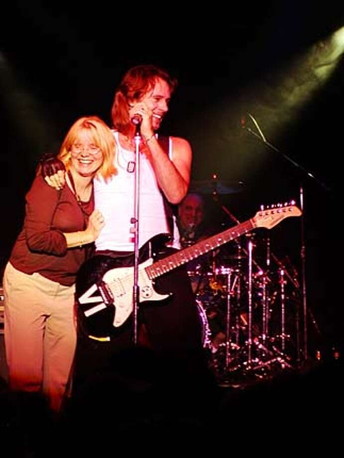 / for: Friday Rita Butzer Carpenter of Palo Alto and Rick  Springfield onstage during a concert at Feather Falls  Casino in Oroville, Calif. on October 10, 2003. Butzer Carpenter is a member of Springfield's Shock Street Team, a grass-roots effort to promote his new album. Photo: Michael D. Dennis Michael D. Den