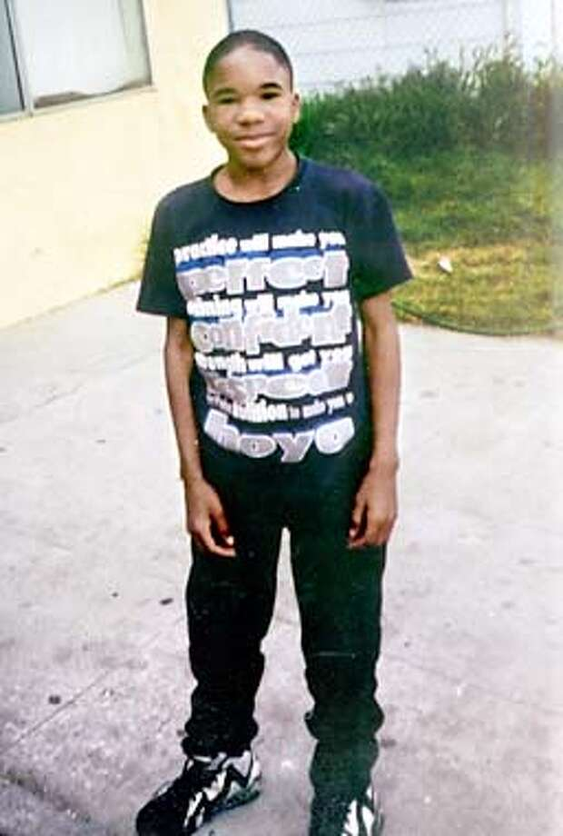 This is a family handout photo of Raymond Bennett from 1996 when he was approximately 14 years old. The 19-year-old Bennett was shot and killed outside a friend's home in West Oakland, Ca., on August 6th, becoming the city's 68th homicide victim. Friends and family are still in shock over the death of what many say are a sweet and innocent young man. His murder remains unsolved. (HANDOUT PHOTO/THE SAN FRANCISCO CHRONICLE) Photo: HANDOUT PHOTO