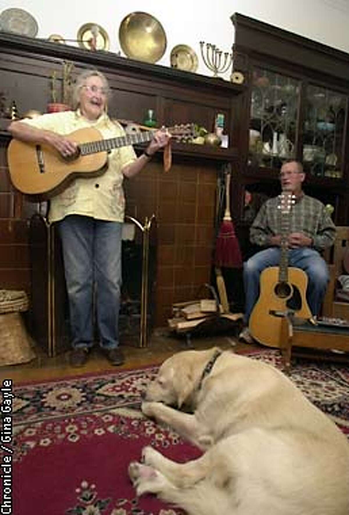 EBPETRICc-C-06SEP02-SF-GG-Folk singer Faith Petric,86 soon to be 87, gets a kick from the song she and the people in the sing-a-long room jam to. Faith hosts jam sessions for the San Francisco Folk Song Club (please check group name) every other weekend and the sessions go late into the night. Photo by Gina Gayle/The SF Chronicle.