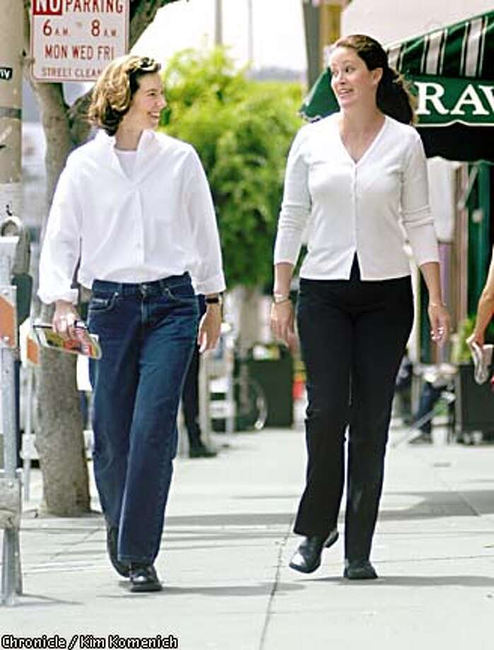 A state error led laid-off advertising agency employee Shelly Lampe (left), walking with former co-worker Jennifer Largaespada, to expect $3,000 in unemployment benefits she won't receive. Chronicle photo by Kim Komenich