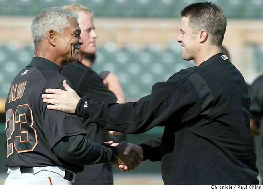 giants26_117_pc.JPG Manager Felipe Alou greets returning first baseman J.T. Snow during the stretching session. The San Francisco Giants held its first full-squad workout on 2/25/04 in Scottsdale, AZ. PAUL CHINN / The Chronicle MANDATORY CREDIT FOR PHOTOG AND SF CHRONICLE/ -MAGS OUT Photo: PAUL CHINN