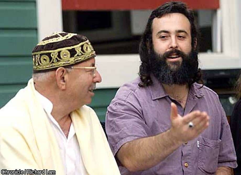 SPECIAL TO THE SAN FRANCISCO CHRONICLE - Eliyahu McLean (right), an Orthodox Jew, and Ibrahim Abuelhaw, a Palestinian Muslim, give a talk about Middle East peace at a Vancouver, B.C. home on Wenesday, July 25, 2002. (CP PHOTO/Richard Lam) Photo: RICHARD LAM