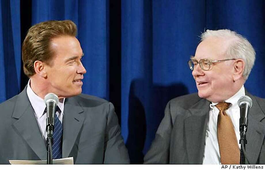 California Governor Arnold Schwarzenegger talks to financial magnate Warren Buffet, right, before a meeting with investors to discuss the sale of $15 billion worth of bonds on the March 2nd ballot in California, Wednesday, Feb. 25, 2004 at the Ritz Carlton in New York.(AP Photo/Pool, Kathy Willens) Photo: KATHY WILLENS