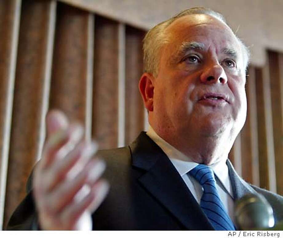 California Attorney General Bill Lockyer gestures during a news conference in San Francisco, Tuesday, Feb. 24, 2004. Lockyer has said he will ask the California Supreme Court on Friday whether San Francisco's issuing of same-sex marriage licenses violated state law to hasten a speedy resolution on whether the couples who wed in San Francisco are legally married. (AP Photo/Eric Risberg) Photo: ERIC RISBERG