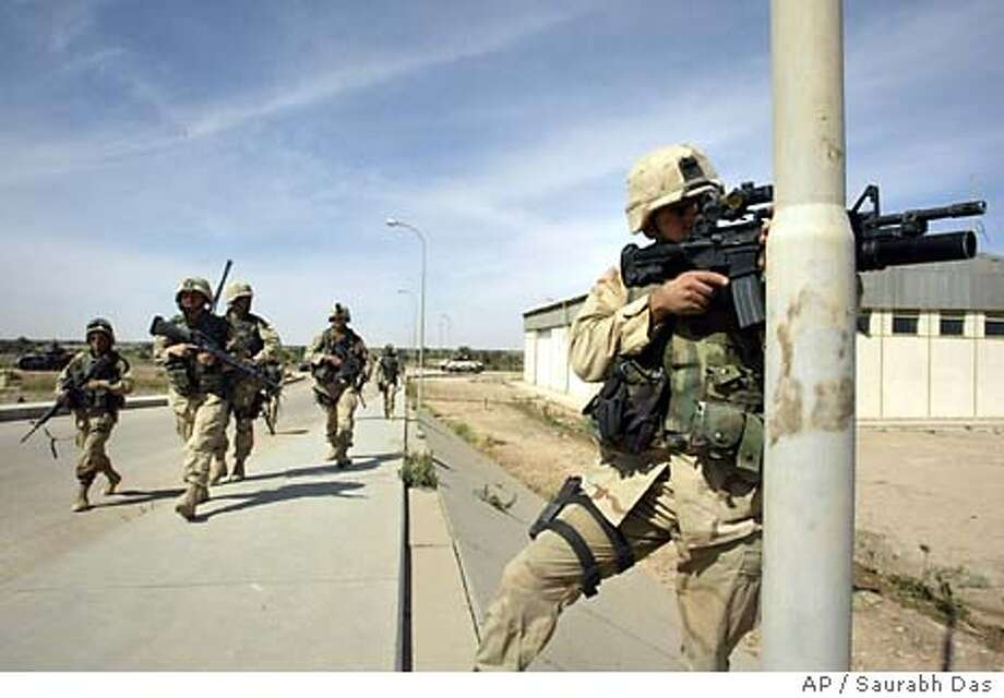 US soldiers on patrol on the outskirts of Najaf, Iraq, Sunday April 18, 2004. (AP Photo/Saurabh Das) Photo: SAURABH DAS