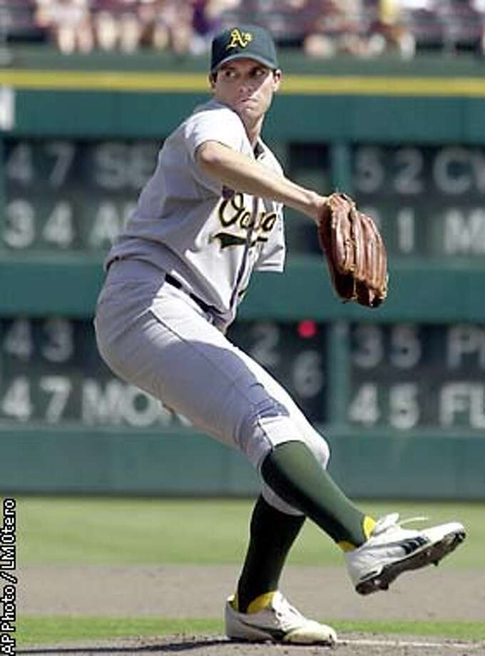 Oakland Athletics pitcher Barry Zito works during the first inning against the Texas Rangers in Arlington, Texas, Sunday, Sept. 29, 2002. (AP Photo/LM Otero) Photo: LM OTERO