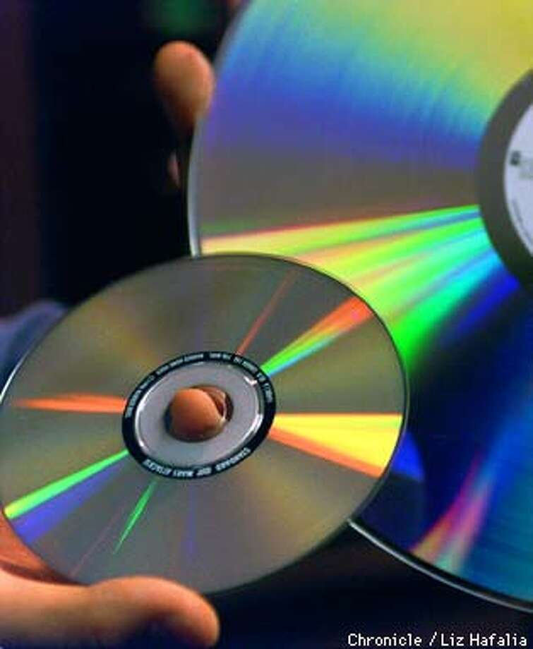 DVD (digital video disk) with laser disk in background. Liz Hafalia Photo: Liz Hafalia