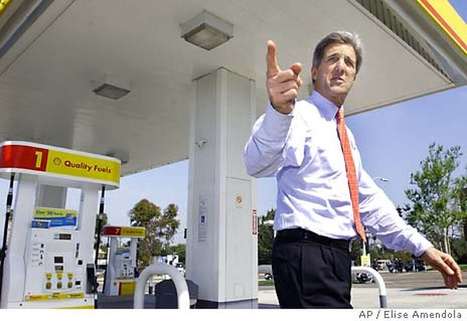 Democratic presidential candidate Sen. John Kerry, D-Mass., walks into a gas station convenience mart to buy a bottle of water and a candy bar in San Diego Tuesday, March 30, 2004. President Bush and Sen. Kerry pointed blame at each other Tuesday for promoting policies that could contibute to the country's escalating gas prices, already at a record high. (AP Photo/Elise Amendola) Photo: ELISE AMENDOLA