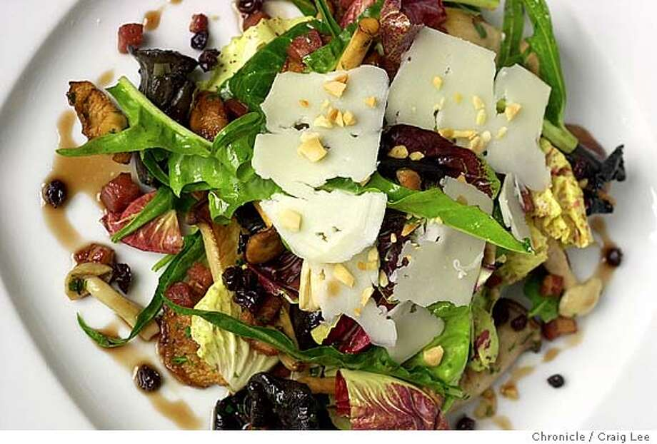 Story on wild mushrooms as a seasonal ingredient. Chef Robbie Lewis of Jardiniere Restaurant. Photo of his wild mushroom salad with pancetta vinegrette and manchego. Event on 2/19/04 in San Francisco. Craig Lee / The Chronicle Photo: Craig Lee