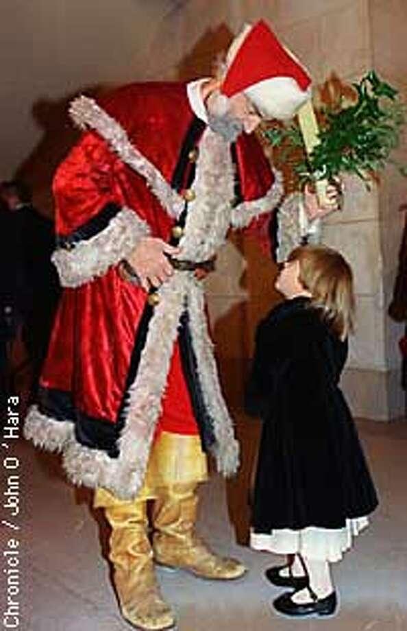 Nutcracker, SF Opera HOuse. Sabrina Werby talks with Santa ( Will Wood) on her way to dinner.  Photo by............John O'Hara Photo: John O'Hara