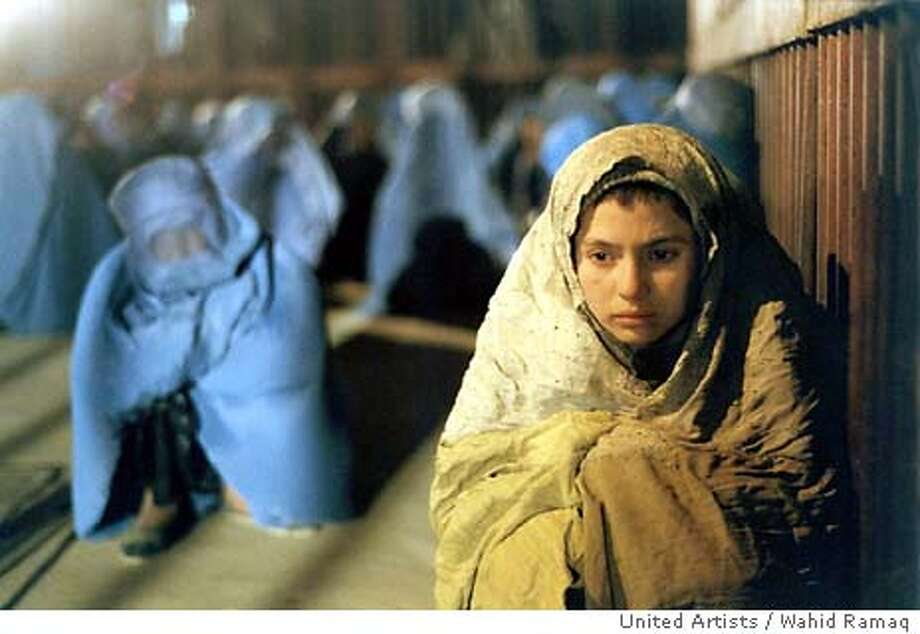 "Marina Golbahari stars as a young girl forced to pose as a boy named Osama in United Artists / Wahid Ramaq drama ""Osama."" (AP Photo /Wahid Ramaq) Marina Golbahari stars in &quo;Osama&quo; as a girl who poses as a boy to get by in Taliban-controlled Afghanistan. Photo: WAHID RAMAQ"