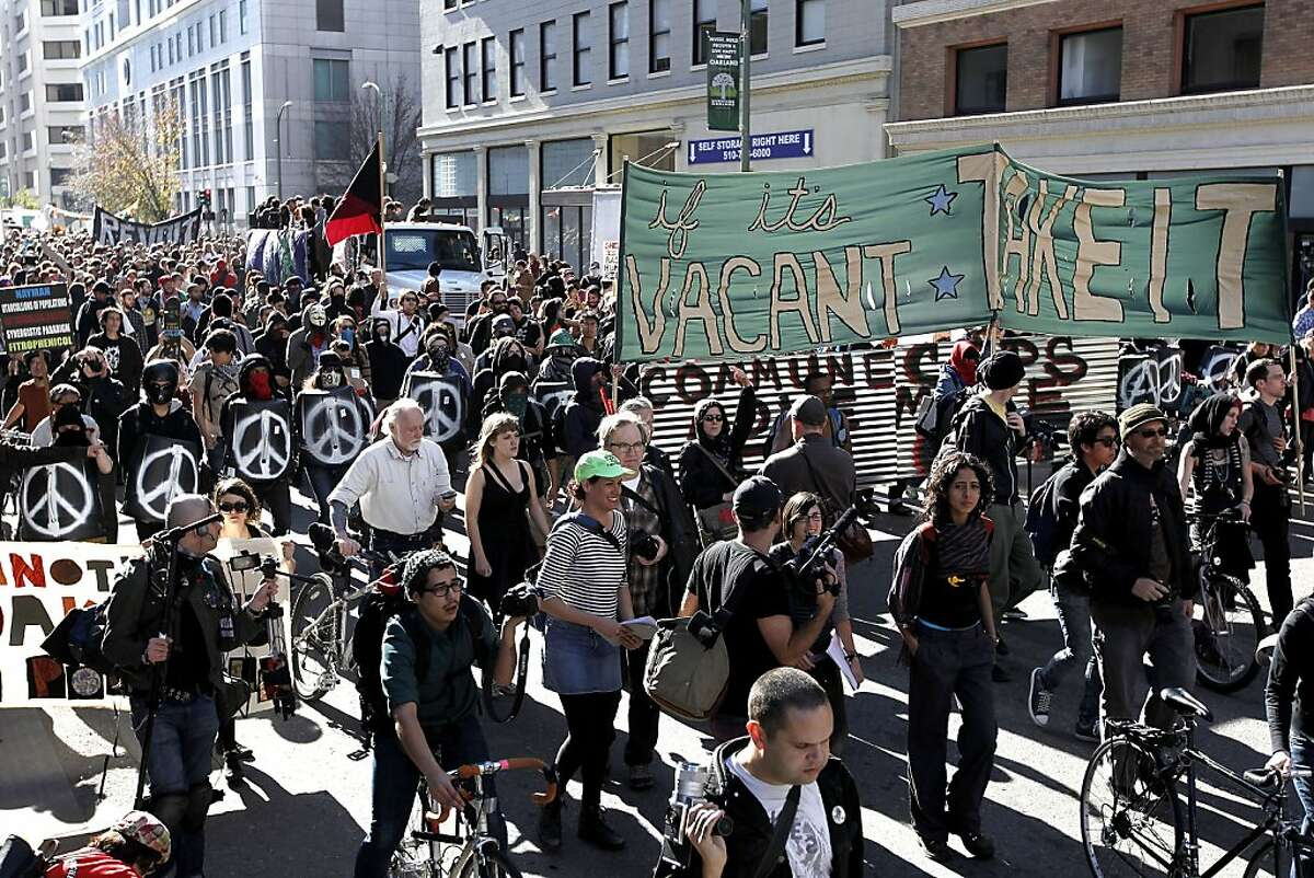 Protesters with Occupy Oakland march through the streets of downtown in Oakland, Ca. on Saturday January 28, 2012. With plans to take over a vacant building, Occupy Oakland spokesman Leo Ritz-Barr said the action