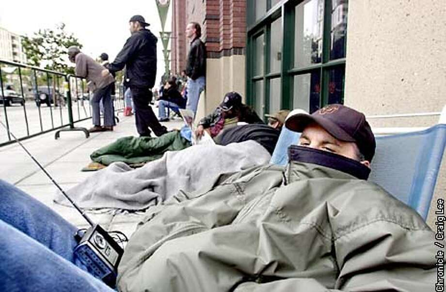 Giants fans waiting in line for play off tickets at Pac Bell Park. Photo of David Handley of San Francisco with his portable radio.  Photo by Craig Lee/San Francisco Chronicle Photo: CRAIG LEE