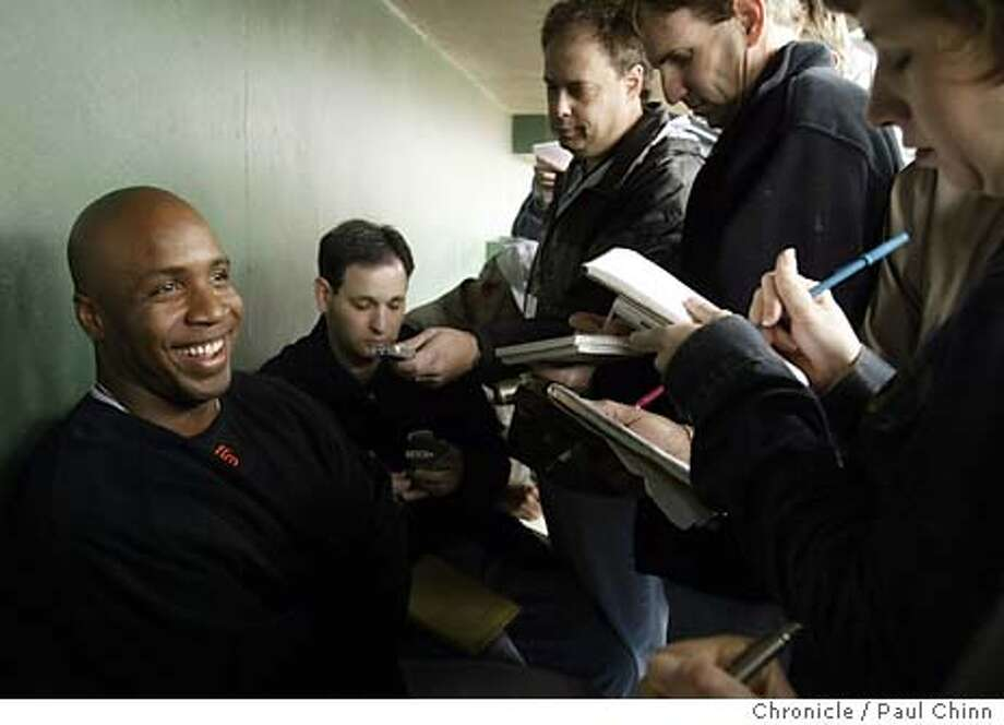 giants24_095_pc.JPG Barry Bonds met with sportswriters in the dugout at Scottsdale Stadium on Monday. Giants slugger Barry Bonds reports for 2004 Spring Training camp on 2/23/04 in Scottsdale, AZ. PAUL CHINN / The Chronicle Photo: PAUL CHINN