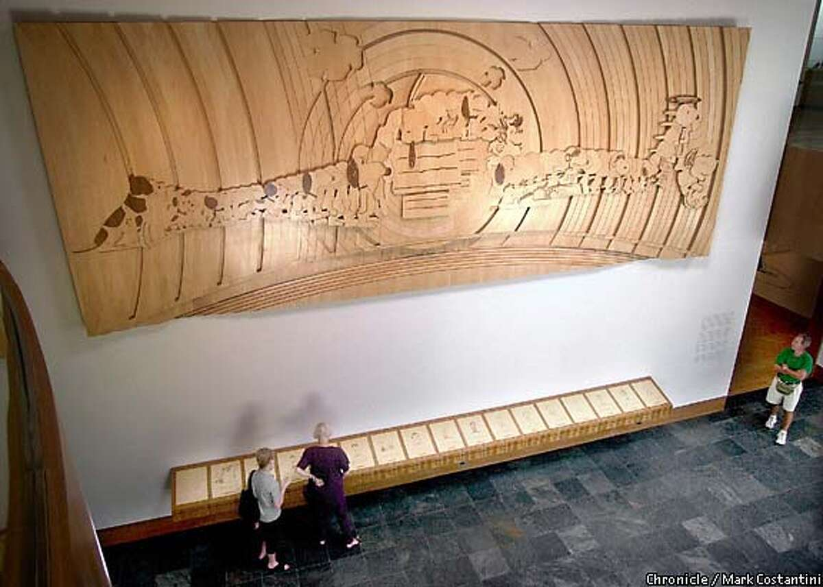 A carved mural by Japanese artist Yoshiteru Otani portrays the evolution of Snoopy from his origin (as Spike, Schulz's childhood pet) through the exuberant beagle's modern look. Chronicle photo by Mark Costantini