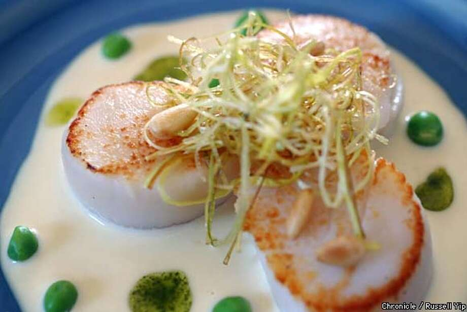 Scallops with lemon beurre blanc. Chronicle photo by Russell Yip