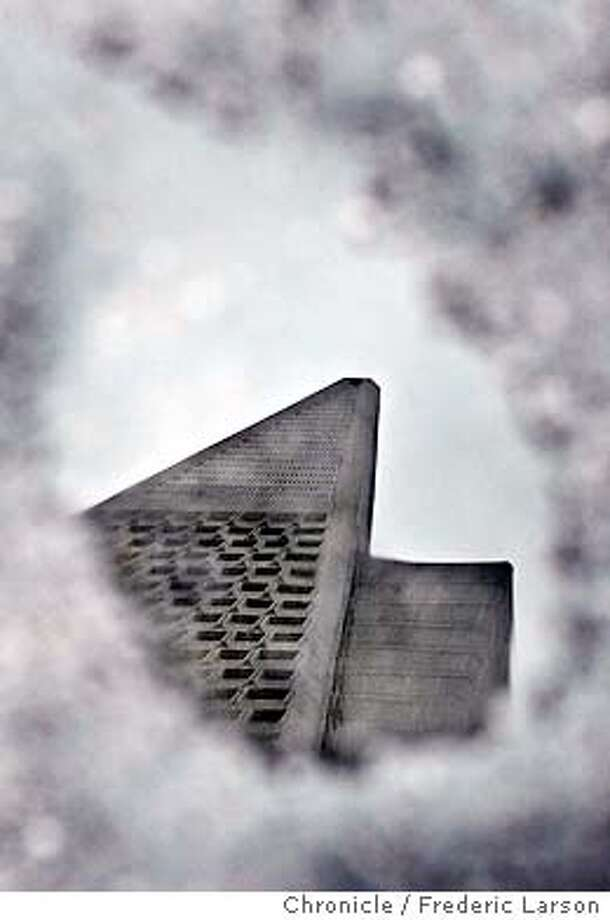 ; San Francisco TransAmerica Pyramid reflected in the rain is signs of more warm winter wet weather that will engulf the Bay Area this week. Weather fronts are stack up off the Pacific coast with mid-week getting most of the front. City:� 2/22/04, in San Francisco, CA. Frederic Larson/The Chronicle; Photo: Frederic Larson
