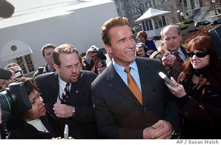 California Gov. Arnold Schwarzenegger is surrounded after speaking to the press at the White House, Monday, Feb. 23, 2004. The Nation's governors met with President Bush earlier in the day. Despite the rising tensions and rhetoric of a presidential race, the nation's governors are looking to Bush and his administration for more support on education, health care and job-producing road spending. (AP Photo/Susan Walsh) Photo: SUSAN WALSH