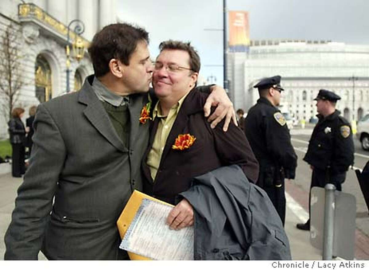Paul Baumann gives spouse Robert Allen a kiss outside San Francisco City Hall after being married, Monday Feb.23, 2004, as the small crowd cheered. The crowd grew smaller due to the fact that couples now have to call to make an appointment to wed instead of just showing up at City Hall. Event on 2/23/04 in SAN FRANCISCO. LACY ATKINS / The Chronicle