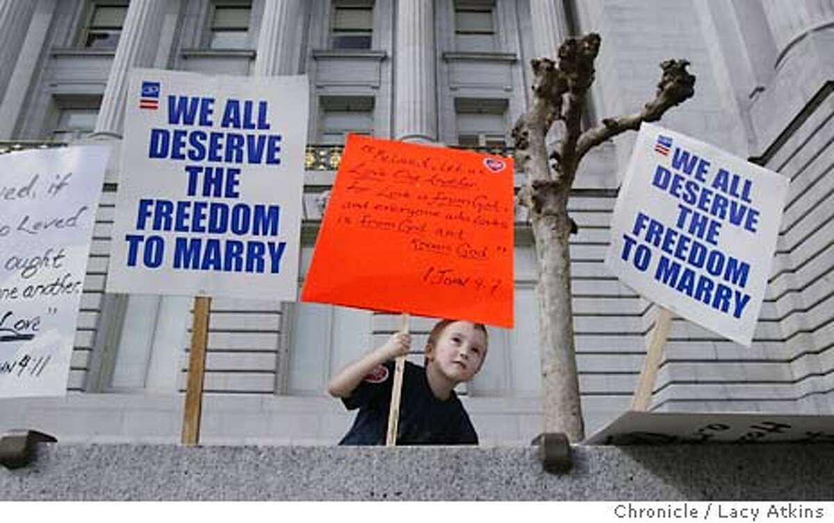 Jesses Brinson-Wagner, 5 years old, holds a sign quoting the book of John 4:1 of the Bible outside the San Francisco City Hall. His mothers Kathy and Jan, form Washington State are being married March 8 in San Francisco. Event on 2/23/04 in SAN FRANCISCO. LACY ATKINS / The Chronicle