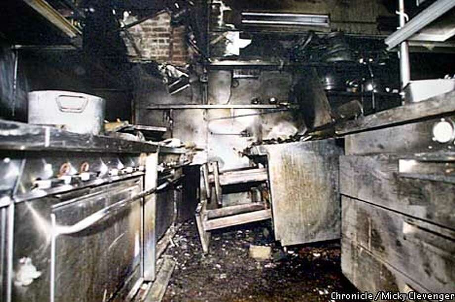 Before: Photo taken on Sept. 8, 2001, shows the extent of the fire damage in the kitchen. Photo by Mickey Clevenger, special to the Chronicle