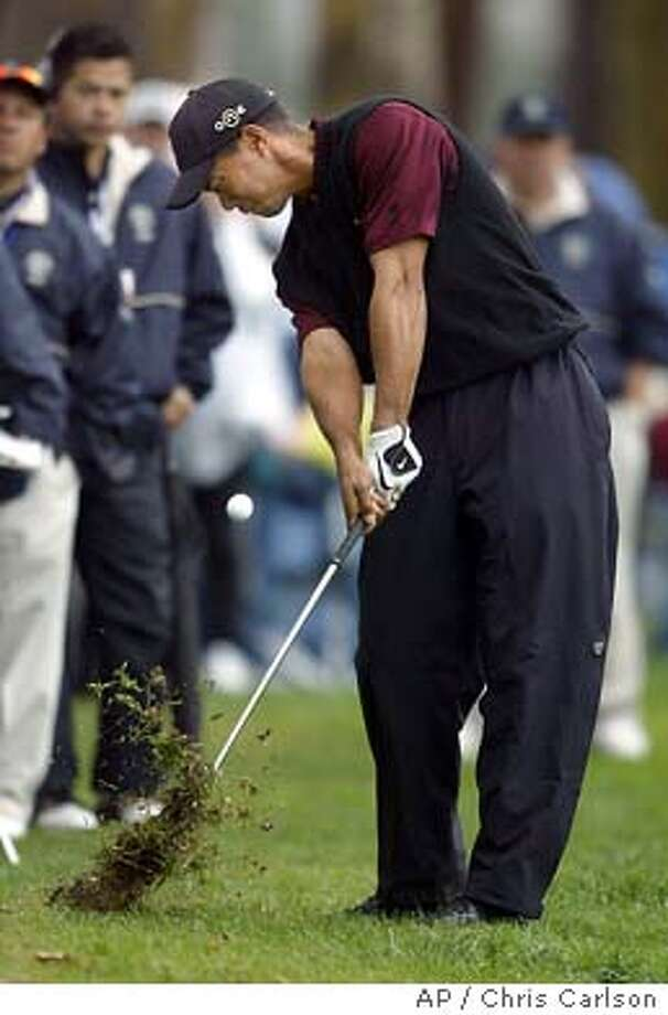 Tiger Woods hits from the rough on the 12th hole during the final round of the Nissan Open at Riviera Country Club in Los Angeles' Pacific Palisades area Sunday, Feb. 22, 2004. Woods shot 64 and tied for 7th place. (AP Photo/Chris Carlson) Photo: CHRIS CARLSON