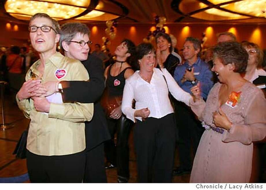 Susan Shain embraces wife Sally McCaffrey, left, among hundreds of married couples at wedding reception held at the Hyatt Regency. Phyllis Lyon and Del Martin were among the hundreds to attend a wedding reception at the Hyatt Regency Sunday Fed. 22, 2004, in San Francisco.  Event on 2/22/04 in SAN FRANCISCO. LACY ATKINS / The Chronicle Photo: LACY ATKINS