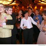 Susan Shain embraces wife Sally McCaffrey, left, among hundreds of married couples at wedding reception held at the Hyatt Regency. Phyllis Lyon and Del Martin were among the hundreds to attend a wedding reception at the Hyatt Regency Sunday Fed. 22, 2004, in San Francisco.  Event on 2/22/04 in SAN FRANCISCO. LACY ATKINS / The Chronicle