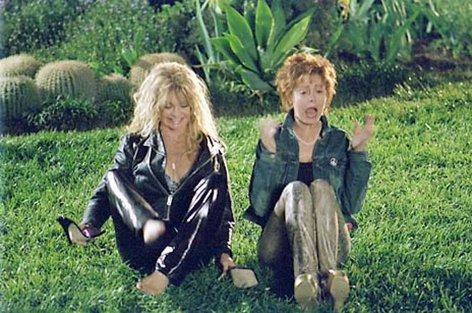 Undated handout photo of Goldie Hawn and Susan Sarandon sitting on the grass. Photo: Handout
