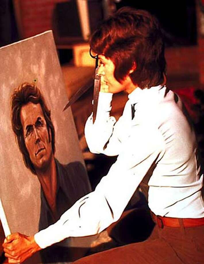 """/ for: Sunday Datebook Jessica Walters aims scissors at a portrait of Clint Eastwood in """"Play Misty for Me.''"""