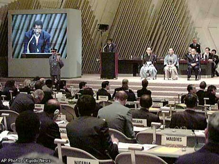 Chim Ten Gwende of Zimbabwe, chairman of the last year's Second Conference of Parties to the United Nations Framework Convention on Climate Change, or COP2, addresses the opening of the 10-day Climate Change Treaty talks in Kyoto, western Japan, Monday, Dec. 1, 1997. Some 1,500 delegates are taking part in the negotiation over the planet's future, drawn together by a fear of but divided over what to do about it. (AP Photo/Kyodo News)