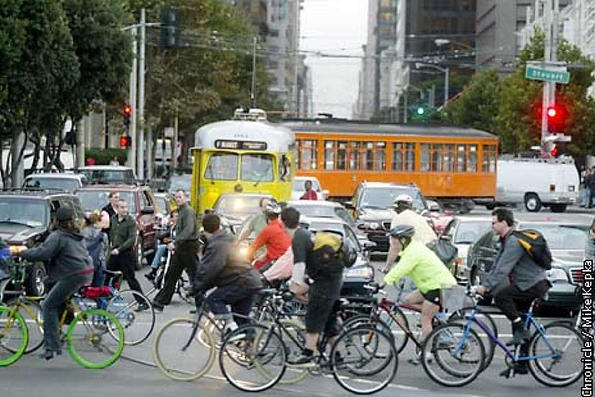 Traffic stands still as it waits for thousands of bike riders to go past on the Embarcadero during the 10 anniversary ride of Critical Mass. BY MIKE KEPKA/THE CHRONICLE