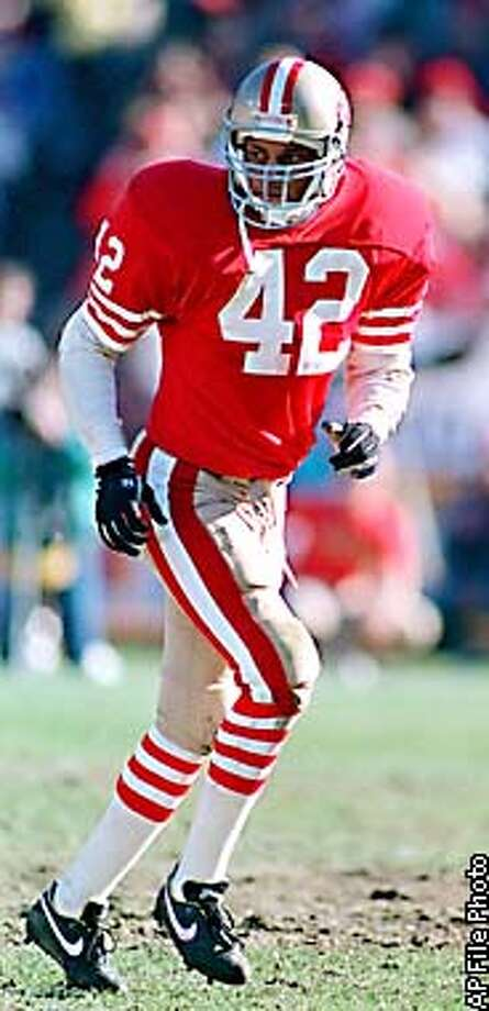 FILE -- San Francisco 49ers free safety Ronnie Lott runs during the NFC Divisional Playoffs against the Minnesota VIkings in San Francisco, in this 1989 photo. Lott will be inducted into the Pro Football Hall of Fame during ceremonies in Canton, Ohio Saturday July 29, 2000. (AP Photo/John Gaps II) Photo: JOHN GAPS III