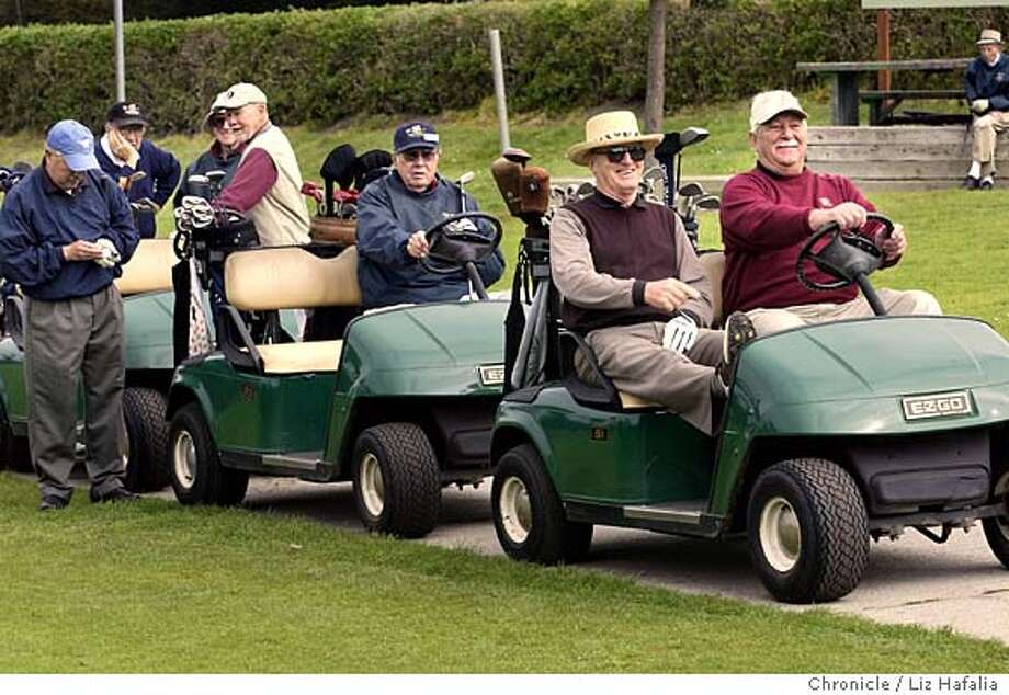 At front is John Lunardi (left, straw hat) and Julian Venturi (right, burgundy sweatshirt) of Sons in Retirement--a club that started in San Mateo 46 years ago has expanded throughout Northern California. About 36 members came today at Sharp Park Golf Course for their weekly game of golf. They use different courses weekly. Shot on 3/24/04 in Pacifica. LIZ HAFALIA / The Chronicle Photo: LIZ HAFALIA