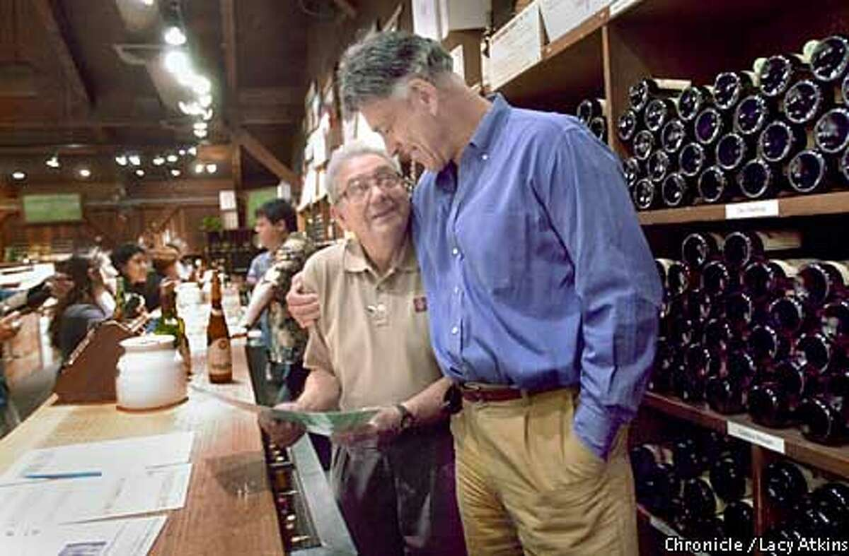 Personal Touch: Daryl Sattui chats with his uncle, George Sattui, in the winery's tasting room. Chronicle photo by Lacy Atkins