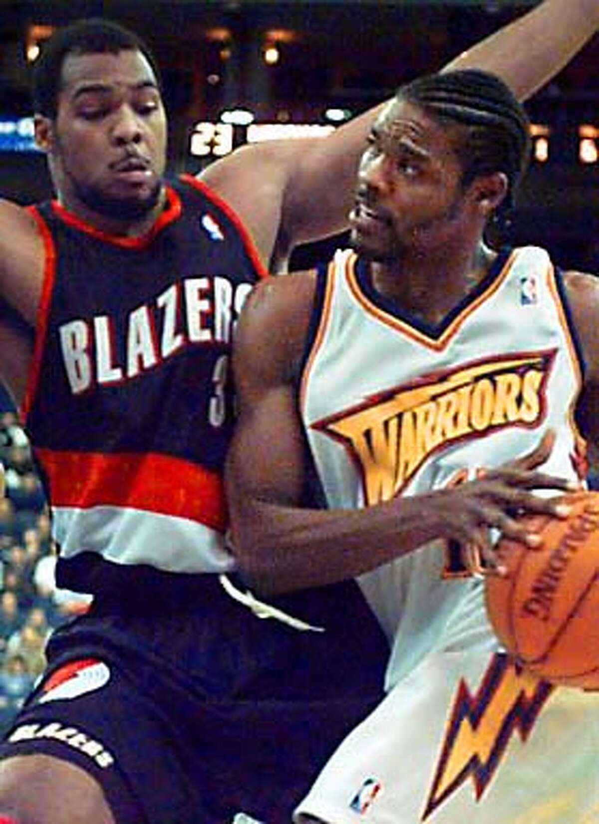 Golden State Warriors Latrell Sprewell, right, leans into Portland Trail Blazers Isaiah Rider, as he goes up for a basket in the first half, Saturday Nov. 15, 1997, in Oakland, Calif. AP Photo / Lacy Atkins