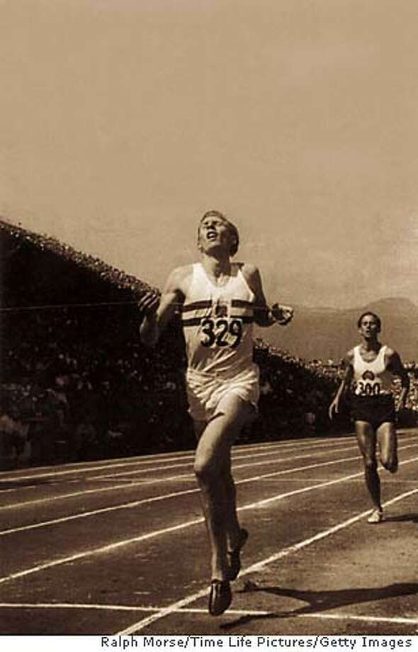 """Roger Bannister wins the Mile of the Century. Photo from """"The Perfect Mile"""" (Houghton Mifflin) to be used with book review only.  Ralph Morse/Time Life Pictures/Getty Images Roger Bannister (left) winning the &quo;Mile of the Century&quo; in Vancouver in 1954."""