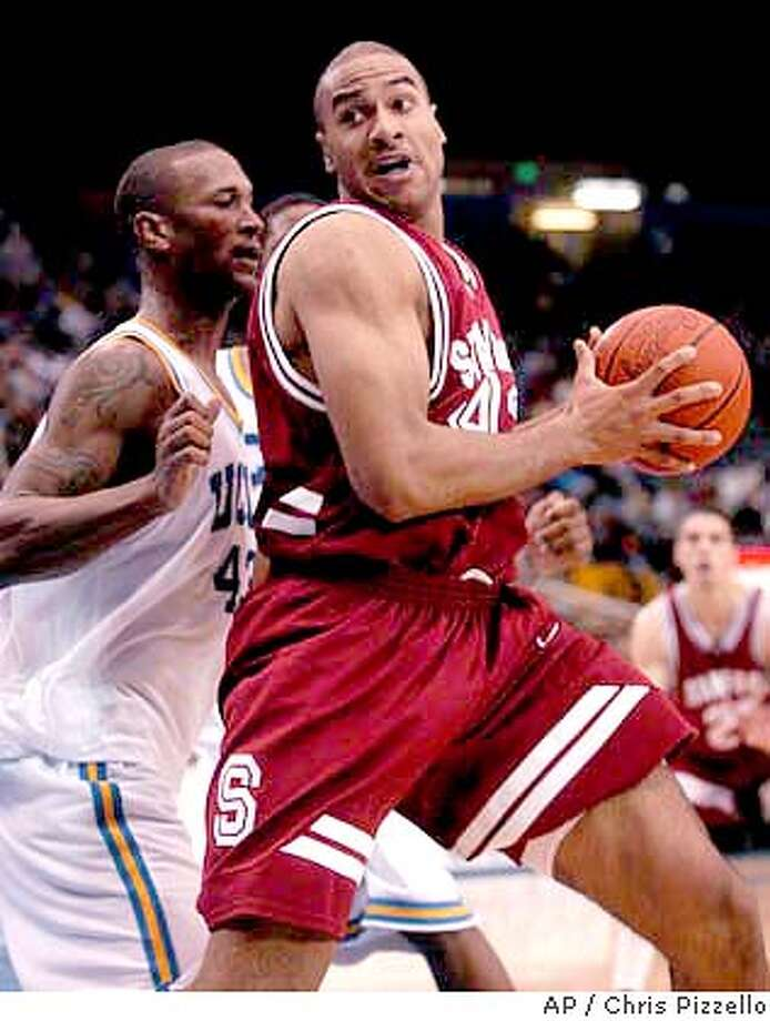 Stanford's Rob Little, right, makes a move to the basket while being guarded by UCLA's T.J. Cummings during the first half at Pauley Pavilion in Los Angeles, Saturday, Feb. 22, 2004. (AP Photo/Chris Pizzello) Photo: CHRIS PIZZELLO