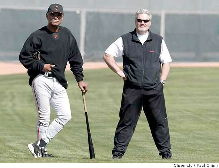 giants22_129_pc.JPG Skipper Felipe Alou and general manager Brian Sabean watch pitchers throw heat at Saturday's workout. The San Francisco Giants spring training workout on 2/21/04 in Scottsdale, AZ. PAUL CHINN / The Chronicle MANDATORY CREDIT FOR PHOTOG AND SF CHRONICLE/ -MAGS OUT Photo: PAUL CHINN