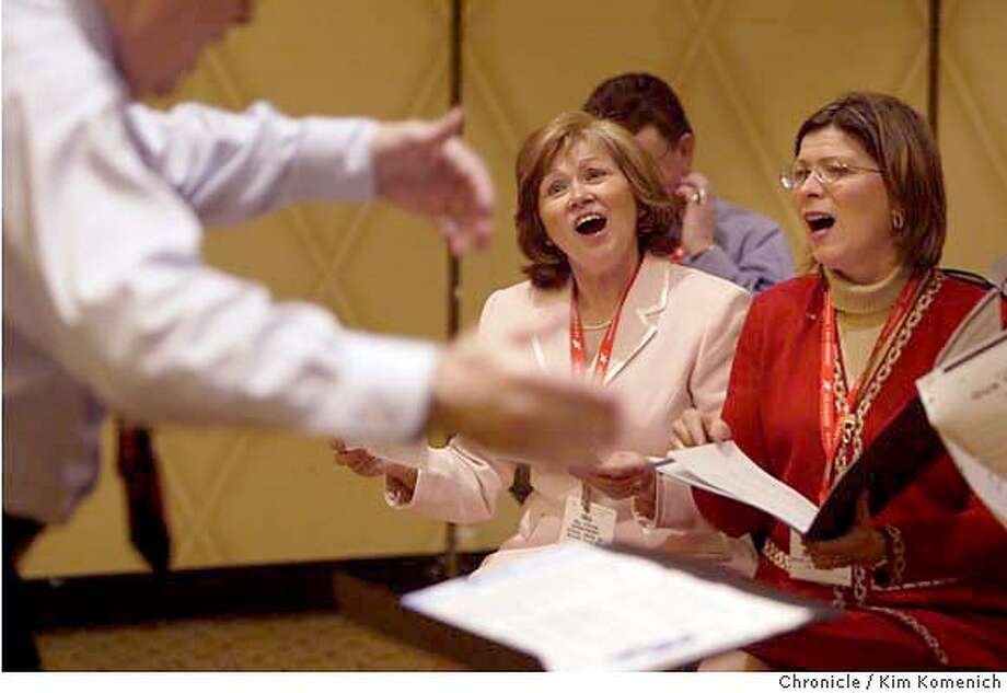 Mechanic Falls, Maine Union 29 Superintendent of Schools Nina Schlikin, left, and Butler School District 53 Superindendent of Schools Sandra Martin, right, sing as Fort Smith, Arkansas Superintendent of Schools Benny Gooden conducts a rehearsal of the Singing Supervisors. They will perform on Sunday at the American Association of School Administrators convention at Moscone Center  Photo by Kim Komenich in San Francisco. Photo: Kim Komenich